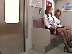 Two adorable Japanese office babes having sex in a bus