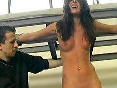 Chick bound by rope and whipped over her back