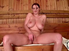 Softcore tit fondling with solo girl in sauna