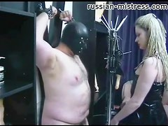 Mistress in latex tempts bound fat guy