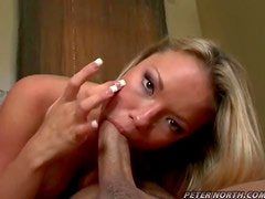 Playful Maya Hills sucks a cock with a smile on her face
