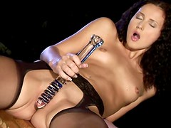 Curly Haired Gal Sticks Big Dildo Up Her Snatch