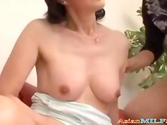 Mature Asian Woman Sucking Guy Getting Her Pussy Stimulated With Vibrator On The Couch