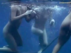 Three girls jump off the boat and go swimming
