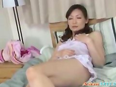 Mature Woman With Hairy Pussy Masturbating Using Vibrator On The Bed In The Bedroo