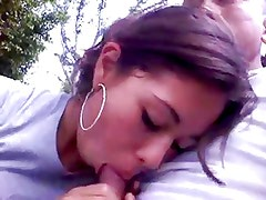 latin girl giving a blowjob in the park