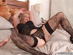 Mature British pornstar Jane Bond dildo play stockings