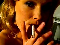 Chick smokes her cigarette in the nude
