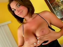 Big tits brunette beauty gives titjob