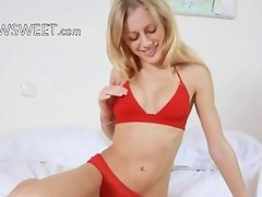 blond plays with sexy toy on the bed