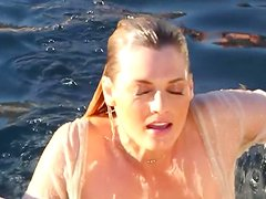 Brigitte Anne fondles her wet body on the poolside