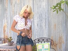 Cute blonde Jana Cova plays with her sweet pussy in the yard