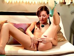 Vixen With Pigtails Inserts Dildo