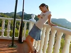 Petite teen toying vagina on the balcony