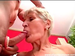 Granny takes out dentures to suck on cock