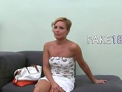 Hot woman teasing with toy on couch