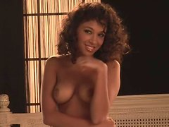 Curly Lauren D'Marie showing her hot body lying on a bed