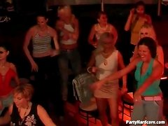 Hot ladies watch the male strippers dance