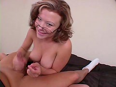 Milf wearing glasses gives a good stroking