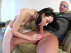 Pretty raven haired hottie gives a sexy blowjob
