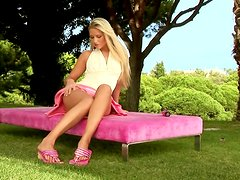 Blonde Plays With Hard Toy Outdoors.