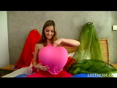 Solo babe plays with balloons and a dildo