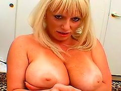 Darling with big natural tits is making hot blowjob