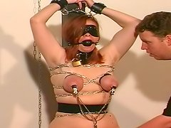 Hardcore babe with blindfold and tits torture