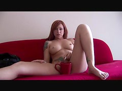 Pierced redhead enjoys a smoke whilst naked