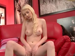 Young blonde has perfect natural tits