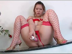 Red lingerie on a pretty girl taking a toy in her cunt