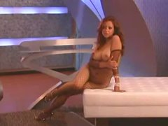 Natalie Taylor's body is barely cover by a sexy fishnet
