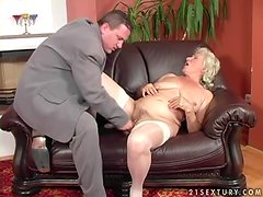 Slutty granny Norma gets her hairy pussy fucked and covered with cum