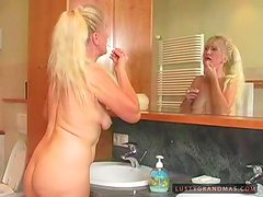 Blonde granny Fresia gets fucked hard in the bathroom