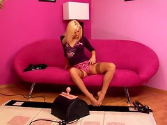 A Blonde Slut Riding Her Cock-Shaped Toy.