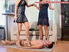 Trampled by two beautiful girls in short dress