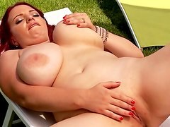 Busty redhead Joanna Bliss shows her natural big boobs