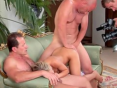 Stunning blonde fucking with two bodybuilders