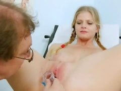 Sexy tits on cute pigtailed girl in exam room