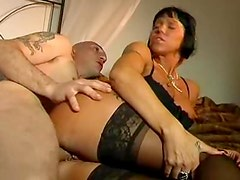 Naughty cougar in sexy black lingerie gets boned