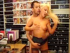 Boning hot milf in a video store