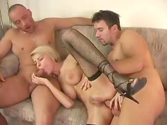 Perky tits chick in fishnets fucked in DP