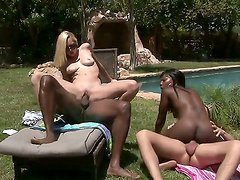 Coffee Brown and Rylie Richman in the interracial swingers party near the pool
