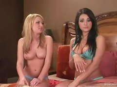 Blonde and brunette babes showing their titties