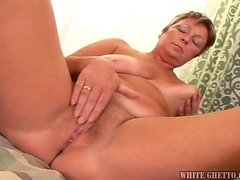 Short-Haired Mature Cock Sucker Giving a Masterful Blowjob