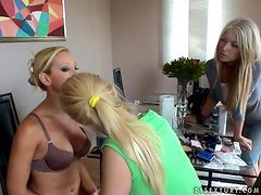 Sexy blonde girl in lingerie sits on a chair and does her makeup