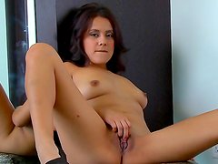 Perfect babe on high heels Selma Sins playing with her puss