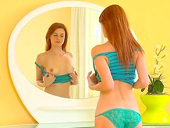 Sage Evans playing with herself in front mirror