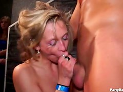 Horny cocksucker on her knees at club