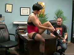 Busty Brunette Blows A Guy With A Foot Fetish.